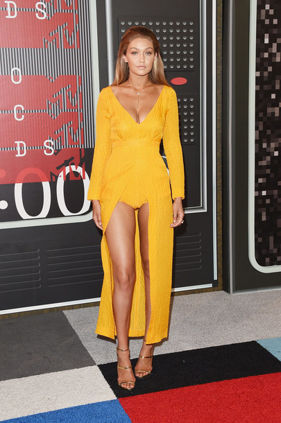 Gigi Hadid Wearing A Yellow Dress From Emilia Wickstead Available