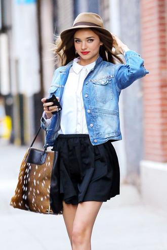 jacket miranda kerr denim coat denim jacket victoria's secret skirt summer hat white shirt black pleated skirt animal print bag blogger