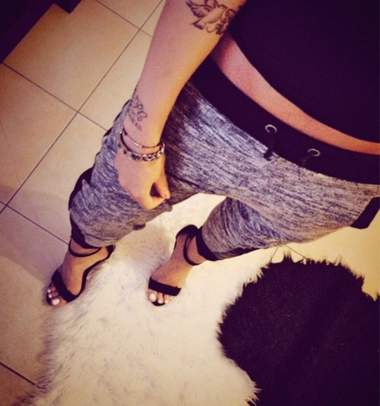 high heels black grey pants sweat sweatpants tattoos