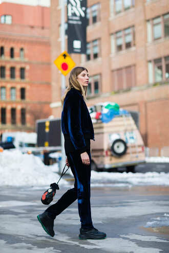 pants velvet jacket nyfw 2017 fashion week 2017 fashion week streetstyle blue pants velvet velvet pants sneakers black sneakers jacket blue jacket bomber jacket bag bucket bag monochrome outfit