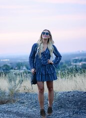 all dolled up,blogger,dress,jewels,bag,sunglasses,shoes,blue dress,long sleeves,round sunglasses,mini dress,shoulder bag,black bag,fringes,ankle boots,bell sleeves,tortoise shell,tortoise shell sunglasses,bell sleeve dress