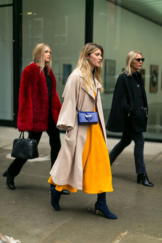 coat blue boots nyfw 2017 fashion week 2017 fashion week streetstyle camel camel coat oversized oversized coat camel oversized coat bag blue bag dress orange orange dress midi dress boots mid heel boots