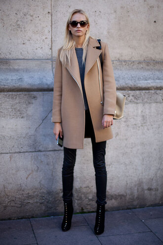 coat camel coat model paris fashion week assymetrical zipper camel biker oversized beige jacket cardigan trench coat fashion coat girl woman's beige pretty brown coat long sleeve brown coat tumblr beige coat leather leggings black leggings leggings boots black boots sunglasses fall outfits