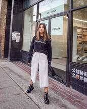 sweater,hoodie,champion,white pants,black boots,patent shoes,lace up boots,black bag,streetstyle