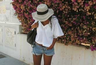 t-shirt white white top white t-shirt wide batwing top irl girl chanel fashion tumblr sun hat vacation batwing blouse batwing tee sunglasses denim shorts shorts brown hair black bag leather bag flowers flower wall bag straw hat blouse