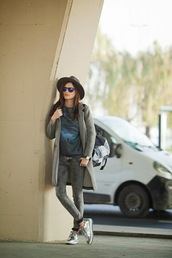 the bow-tie,blogger,hat,grey jeans,metallic shoes,t-shirt,grey coat,coat,jeans,sweater