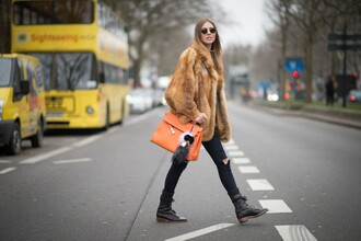 the blonde salad blogger fur coat orange keychain fendi combat boots shoes coat jeans bag sunglasses dress bag accessories winter coat orange bag chiara ferragni ripped jeans black boots flat boots fur keychain big fur coat