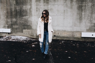 somewherelately blogger coat tank top jeans belt sunglasses shoes winter outfits white coat ankle boots