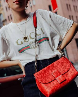 t-shirt tumblr gucci white t-shirt bag orange chain bag necklace gold necklace gold jewelry jewels jewelry skirt blue skirt denim skirt gucci t-shirt logo tee red bag high waisted skirt red leather bag earrings 80s style
