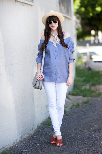 jeans and a teacup blogger shirt jeans hat sunglasses bag shoulder bag white jeans blue top spring outfits mules