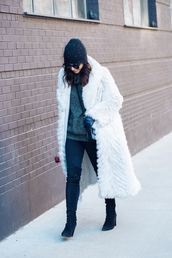 this time tomorrow,blogger,coat,sweater,jeans,shoes,hat,bag,sunglasses,gloves,white fur coat,long coat,white coat,winter coat,winter outfits,beanie,black beanie,grey sweater,black jeans,over the knee boots,over the knee,black boots,high heels boots,black sunglasses