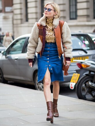 skirt gold top denim slit skirt blue skirt denim skirt button up denim skirt button up skirt top jacket winter jacket brown jacket boots brown boots high heels boots sunglasses blue sunglasses streetstyle bag fringed bag brown bag shoulder bag fall outfits pocket jacket block heels