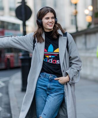 coat london fashion week 2017 fashion week 2017 fashion week streetstyle grey coat t-shirt black t-shirt logo tee adidas adidas t-shirt headphones denim jeans blue jeans