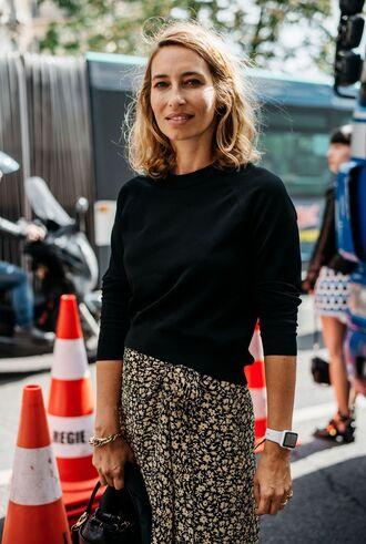sweater fashion week street style fashion week 2016 fashion week paris fashion week 2016 black sweater skirt printed skirt bracelets watch streetstyle