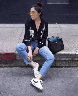 shoes black shirt sunglasses tumblr nike nike shoes nike cortez low top sneakers sneakers denim jeans blue jeans bag black bag shirt yellow sunglasses