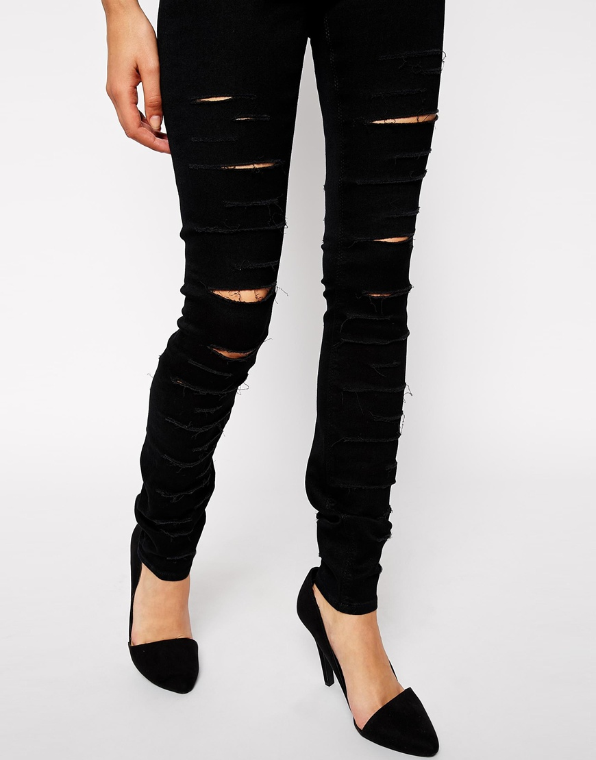 ASOS Ridley High Waist Ultra Skinny Jeans in Black with Extreme Rips at asos.com