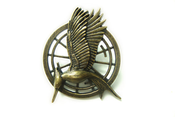 Inspired catching fire mockingjay pin by animecouturejewelry