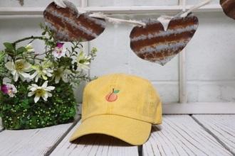 hat yellow orange peach emoji print
