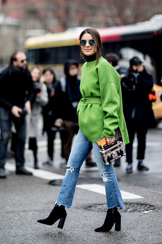 sweater nyfw 2017 fashion week 2017 fashion week streetstyle green sweater oversized sweater oversized denim jeans blue jeans ripped jeans cropped jeans boots black boots high heels boots pointed boots bag boxed bag sunglasses
