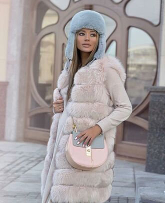 bag street shot from the street streetwear streetstyle celine celine bag cozy comfy pastel bag fur fur vest fashion winter outfits fashion inspo glamour glamgerous pastel