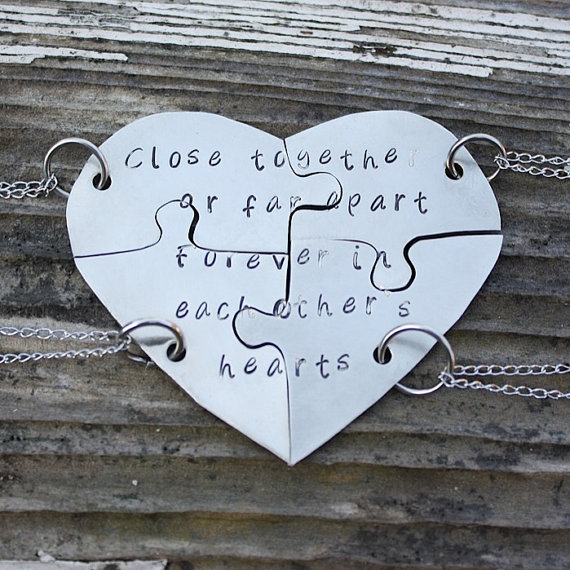 Hand stamped friendship puzzle necklaces, shaped like a heart