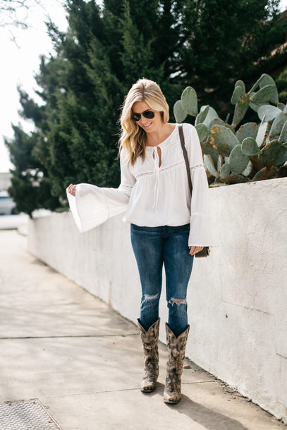 onesmallblonde blogger jacket shoes dress jeans top blouse shoulder bag white blouse bell sleeves knee high boots cowgirl boots
