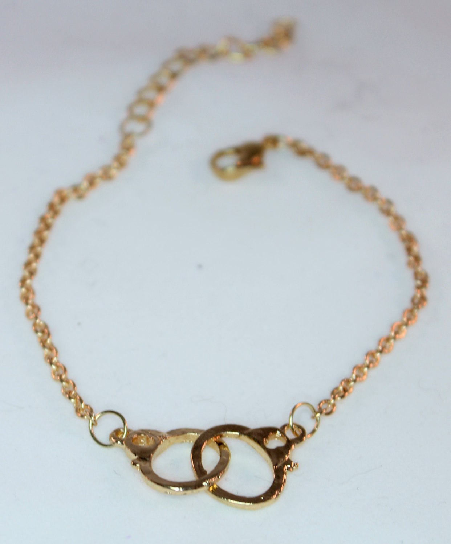 Gold handcuffs bracelet