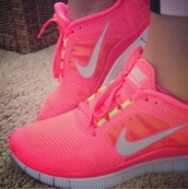 shoes,nike shoes,nike free run,fluo,pink,nike neon trainers,free runners,nike,nike sneakers,sneakers,nike running shoes,i love them. where can i get them,tribal pattern,nike tribal shoes,aztec,aztec nikes,neon pink