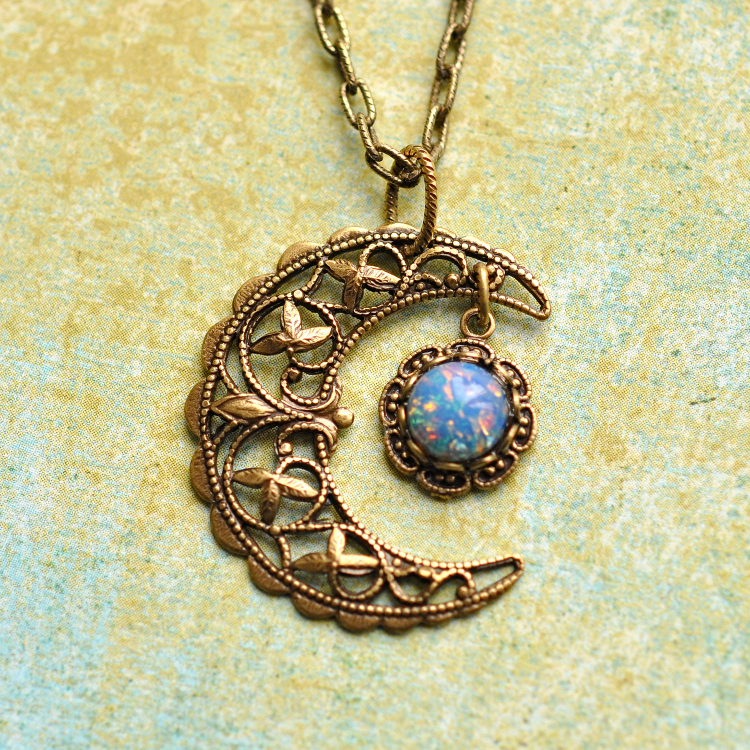 Blue crescent moon necklace. blue glass opal and antiqued brass
