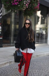 styletomystreet,blogger,pants,leggings,fall outfits,black sweater,red pants,red shoes