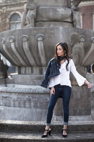 tlnique blogger blouse jewels white blouse skinny jeans denim jacket black shoes bell sleeves black heels bell sleeve top