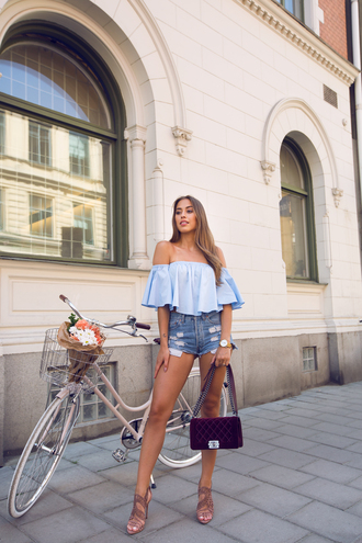 kenza blogger jewels shorts top shoes bag gold watch off the shoulder blue top chanel boy bag boy bag chanel boy blue off shoulder top velvet velvet bag distressed denim shorts denim shorts