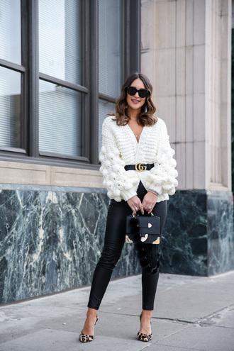 cardigan white cardigan cozy oversized cardigan belt gucci pants black pants leather pants pumps pointed toe pumps high heel pumps leopard print sunglasses