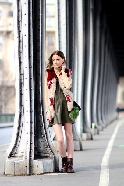 queen of jet lags blogger faux fur vest leather dress printed fur vest vest boots dress mini dress green dress turtleneck stars