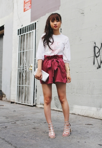 la vagabond dame t-shirt shorts shoes jewels suede shorts high waisted shorts white top quote on it clutch white clutch sandals sandal heels high heel sandals silver sandals silver high heels sandals