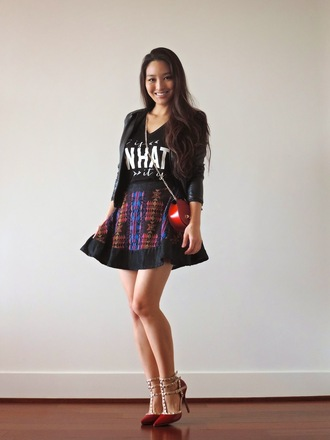 sensible stylista blogger jacket shoes black t-shirt pattern skater skirt red bag graphic tee pointed toe red heels