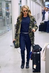 jacket,top,pants,cara delevingne,stripes,camouflage,camo jacket,blouse,camouflage military jacket,striped top,striped pants,blue pants,blue top,round sunglasses,celebrity style,celebrity,headphones