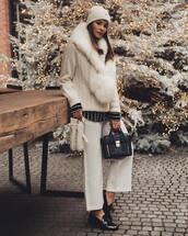 scarf,faux fur,white pants,black loafers,black bag,black shirt,white sweater,white hat,knitwear