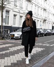 bag,black bag,white sneakers,black pants,black coat,black hat