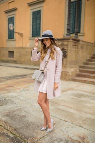 gal meets glam blogger hat pink coat stilettos pink skirt shoulder bag