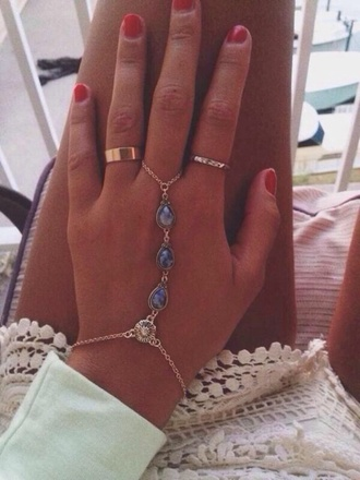 jewels ring bracelets cute blue hand jewelry hand bracelet hand silver flowers chain bracelet chains hipster accessories fashion gold sunflower blue jewelry blue stones slave bracelet gold chain bracelet gold chain blue hand accessory bracelet/rings ring chains