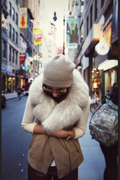 coat,vest,brown,fur,clothes,shearling vest,shearling,beanie,sweater,white sweater,jacket,cap,beige jacket