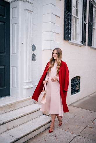 gal meets glam blogger dress coat shoes bag red coat winter outfits pink dress midi dress pink bag red heels high heel pumps vince louboutin mansur gavriel christmas valentines day new year's eve sweet feminine pink red