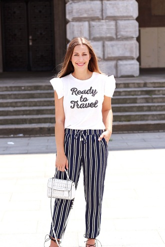 fabesfashion blogger shirt pants shoes bag t-shirt ruffle sleeves striped pants blogger style slogan t-shirts crossbody bag satchel bag