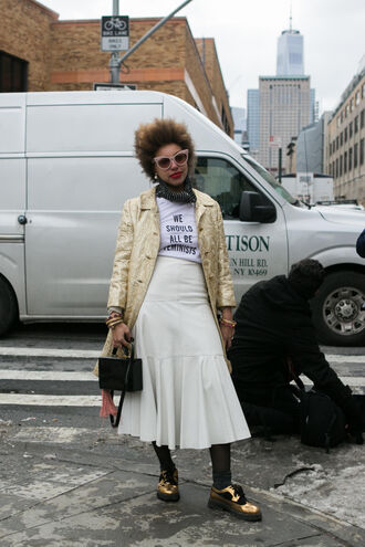 skirt gold coat nyfw 2017 fashion week 2017 fashion week streetstyle midi skirt white skirt t-shirt white t-shirt equality quote on it coat gold metallic tights shoes gold shoes metallic shoes bag black bag boxed bag sunglasses feminist tshirt midi white leather skirt midi leather skirt leather skirt
