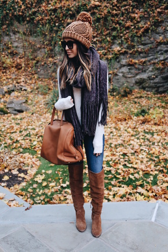 somewherelately blogger sweater scarf jeans shoes sunglasses bag hat fall outfits beanie knee high boots brown bag brown boots knitted beanie suede boots