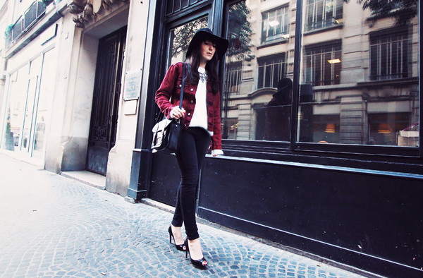 the black feather jacket jeans sweater bag shoes