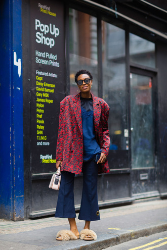 coat printed coat fashion week street style fashion week 2016 fashion week london fashion week 2016 red coat top blue top denim jeans blue jeans flare jeans cropped jeans denim culottes culottes slide shoes furry slides bag nude bag fall outfits streetstyle sunglasses furry shoes