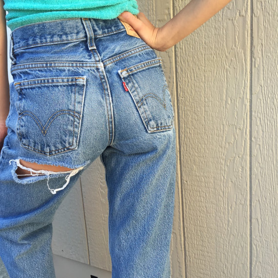Cheeky Hand distressed vintage 1990's grunge rock 550 red label high waisted Levi's denim jeans with butt cheek cut out women's 27 waist