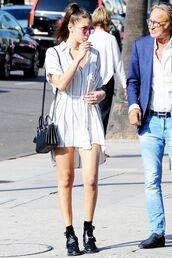 dress,bella hadid,celebrity style,celebrity,model,striped dress,white dress,summer dress,boots,black boots,bag,ysl bag,ysl,black bag,sunglasses